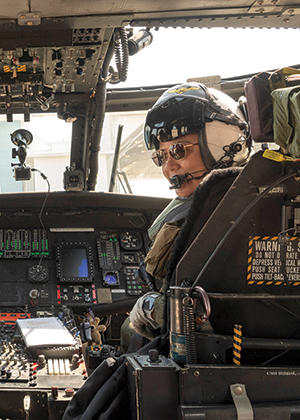 Gordon, the Navy's first to receive the Army's Broken Wing Award, prepares for a performance flight demonstration in the same UH-60L Black Hawk. (U.S. Navy photo by Liz Wolter)