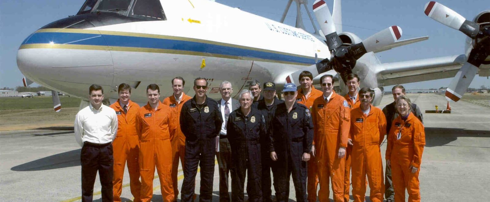 Carla Jackson poses with members of NAVAIR, Lockheed, and US Customs after a P-3 flight test